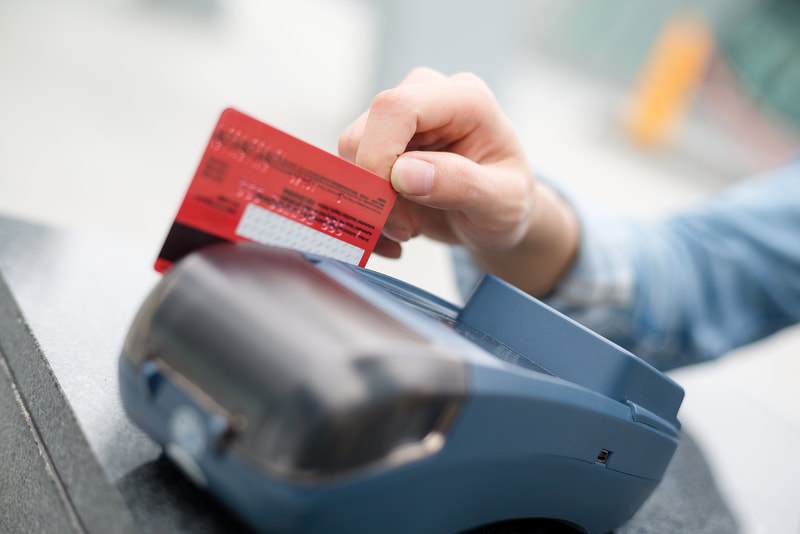 man paying using card