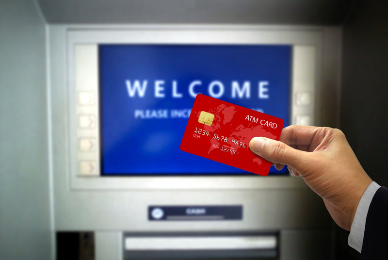 man holding an ATM card
